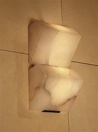 deux paires d'appliques en fer patiné noir et deux blocs d'albâtre by pierre chareau