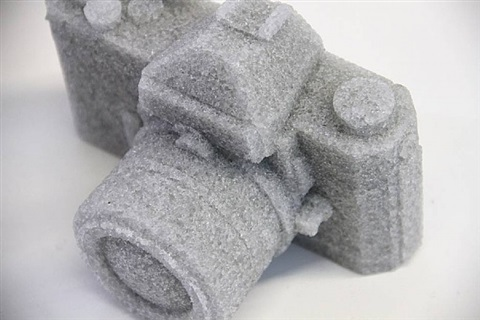 grey glass camera by daniel arsham