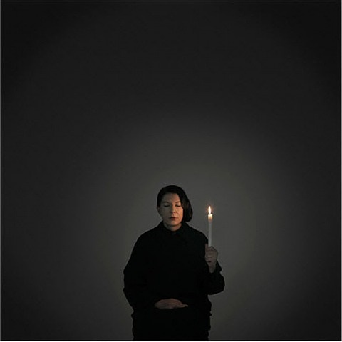 artist portrait with a candle by marina abramovic