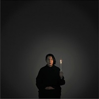 artist portrait with a candle by marina abramović
