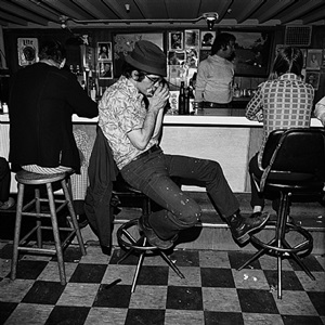harmonica player, merchant's cafe, nashville, tennessee by henry horenstein
