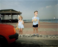 children eat ice creams on the seafront, new brighton, england by martin parr