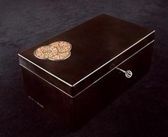 coffret en bois laqué noir à décor de médaillons en métal doré by jean dunand