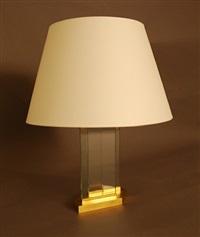 lampe composée de deux lames de verre enchâssées dans une base hexagonale en bronze doré by jean-michel frank