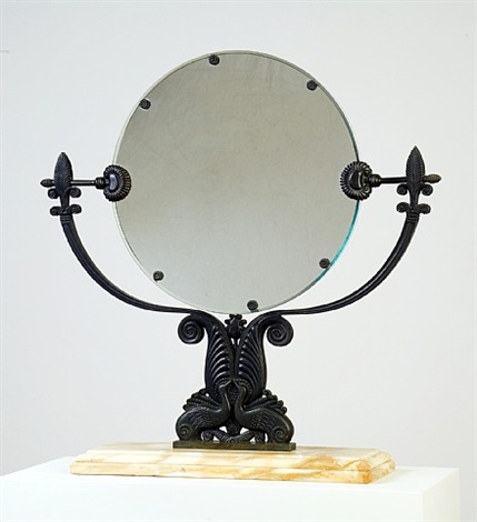 miroir de table pivotant en bronze à patine vert antique finement ciselé, sur un socle en marbre. la base formée de deux oiseaux supportant des palmes, le miroir orné de marguerites by armand-albert rateau