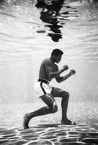 cassius clay training in a pool at the sir john hotel in miami by flip schulke