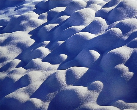 snow covered river stones, wyoming by christopher burkett