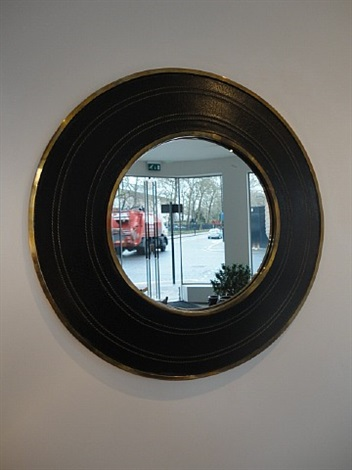 a stitched black leather and brass mirror by mathieu matégot