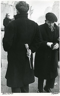man with tulip, paris by robert frank