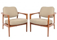 pair of dux lounge chairs by folke ohlsson