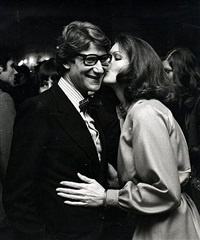 yves saint laurent and lois chiles attend yves saint laurent fashion show at the pierre hotel, new york by ron galella
