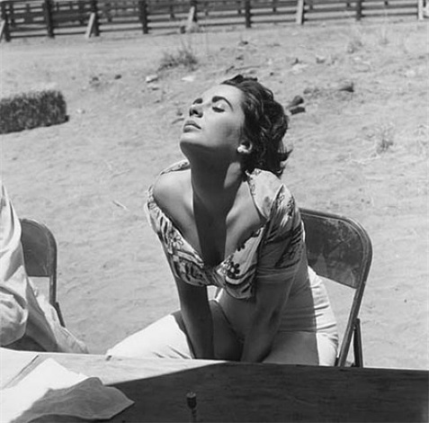 "elizabeth taylor sunning herself on the marfa, texas set of ""giant"" by sid avery"