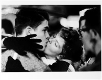 couple kissing, man looking away, new year's eve by jay maisel