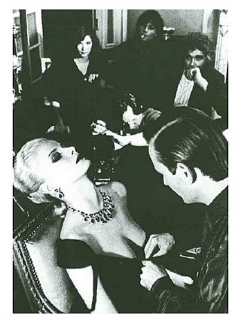 woman being filmed, paris 1980 by helmut newton