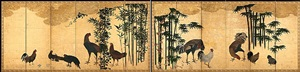 roosters and chicken in a bamboo grove