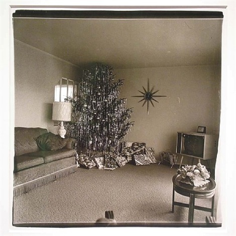 xmas tree in a living room, levittown, l.i. by diane arbus