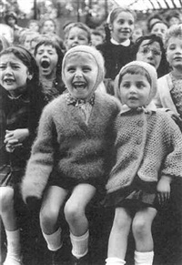 children at a puppet theater iii (girl laughing) by alfred eisenstaedt