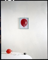 balloon, rock on table with painting by john chervinsky