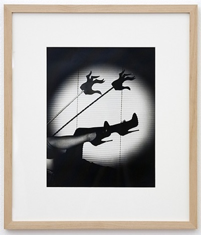 untitled (sandy stagg models the miss general idea shoe and the hand of the spirit against the backdrop of luxon v.b.) by general idea