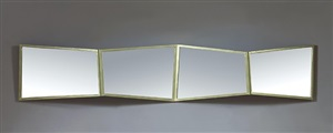 large, rectangular, gilt metal mirror with four asymmetric facets opening up in a fan shape by libor david