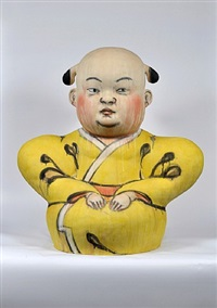 seated man in yellow robe by akio takamori