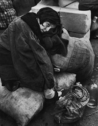 tired little girl amidst refugees, 1936 by robert capa