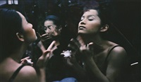 yogo and c putting on make up, second tip, bangkok by nan goldin