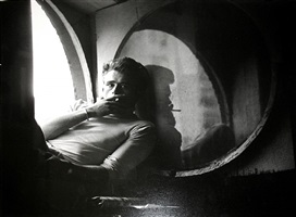 james dean sitting in the window of his west 68th street apartment by roy schatt