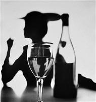 girl behind wine bottle (jean patchett), new york by irving penn