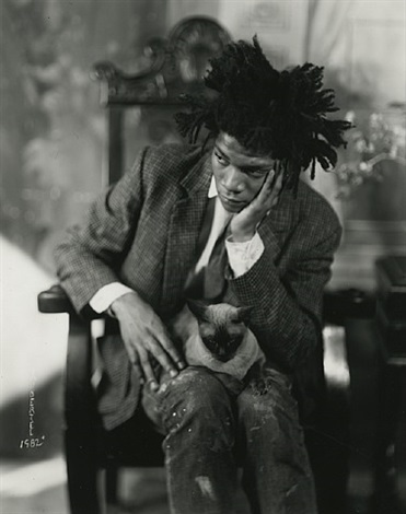 jean michel basquiat with cat on lap by james van der zee