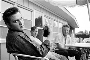 pepsi in hand: elvis presley sitting on the porch of his home at 1034 audobon drive, memphis, tennessee by alfred wertheimer