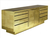 a gold cityscape console by paul evans by paul evans