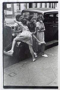 n.y.c (4 girls leaning against car) by helen levitt
