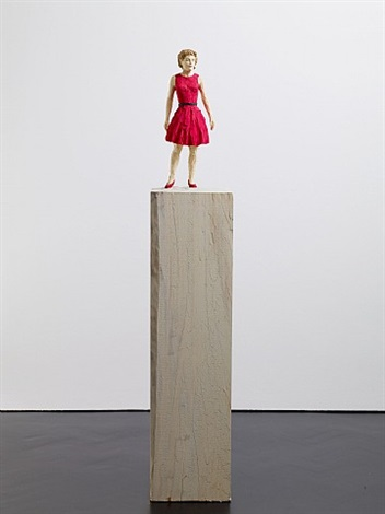 woman in red dress by stephan balkenhol