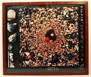 zara beard in her sand box of stones, driftwood cove, montauk by peter beard