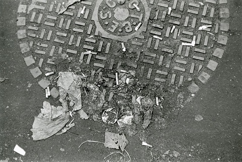 debris on a manhole cover, new york, 1968 by walker evans