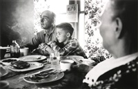 ranch boy with father by elliott erwitt