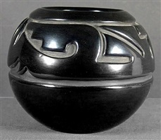 curvilinear spiral carved blackware jar by margaret tafoya