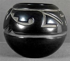curvilinear spiral carved blackware jar by margaret tafoya