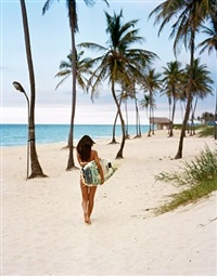 rachel going for a surf, playa del este by michael dweck