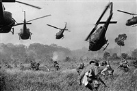 hovering u.s. army helicopters pour machine-gun fire into the tree line to cover the advance of south vietnamese ground troops as they attack a viet cong camp eighteen miles north of tay ninh, near the cambodian border by horst (ph) faas