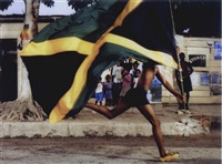 an unidentified jamaican boy uses the puma h street running shoe to run for his freedom by hank willis thomas