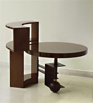 table-bibliothèque en noyer et fer battu patiné noir by pierre chareau