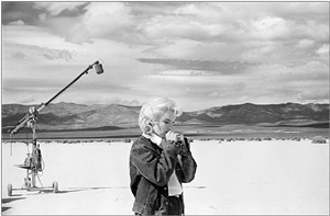 """usa. nevada. us actress marilyn monroe on the nevada desert going over her lines for a difficult scene she is about to play with clarke gable in the film """"the misfits"""" by john huston. 1960. by eve arnold"""