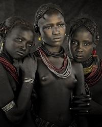 bodita, arboshash & nirjuda, dassanech tribe <br />omorate village, southern omo valley, ethiopia by jimmy nelson