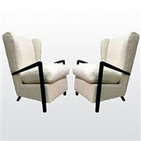 pair of jean royère wing arm-chairs /paire de fauteuils a oreilles by jean royère