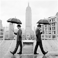 reed and nathan with umbrellas, new york by rodney smith