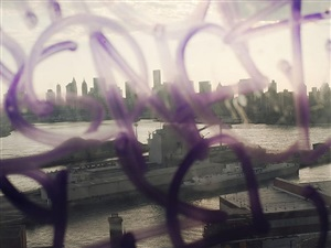 usa. nyc. 2011. view of manhattan and the brooklyn navy yards through a window covered in graffiti. by christopher anderson