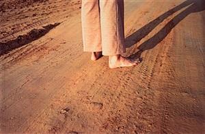 untitled, (feet on earth road) by william eggleston