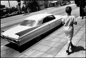 woman walking along, wilshire blvd, from the los angeles series by bruce davidson